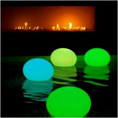 Put a glow stick in a balloon for a pool lantern. This is so cool.
