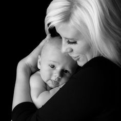 Mother and Baby Picture.  I like the black outfit with a black background to place the emphasis on the faces.