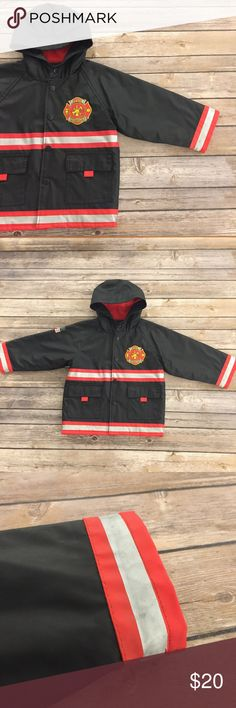 Western Chief Rain Coat, 2T Western Chief Rain Coat, 2T, black firefighter rain jacket with classic fire badge, lettering, stripes, etc. hood, snaps closed, Lined to make it cozy. VGUC for light wear. Western Chief Jackets & Coats Raincoats