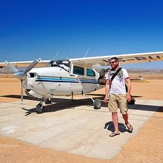 Dan...Another #happy #touchdown, another successful #landing. On the #airstrip of #SerraCafema, the #safarilodge in the #remote #Kaokoland of #Namibia. #ProTip: take #softbags only if your #travels involve small #airplanes. || #lifestyle #life #guy #NamibDesert #journey #man #travelfashion #holiday #vacation #fashion #traveling #desert #cessna #aircraft #plane || Photo by #Travel+#Style. More from Namibia:  http://www.travelplusstyle.com/?s=Namibia