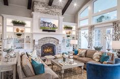 Cozy traditional style beige and blue living room decor with beige sofas and blue swivel armchairs