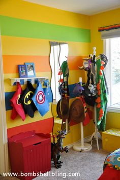 I LOVE this idea!  Set up a make-believe / dress-up corner in your kid's room!  Kid heaven.