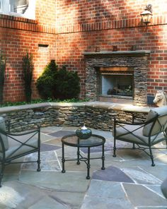 Outdoor stone fireplace; living area.