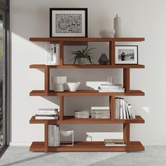 null Display all your books, plants, objets, and photos on this stylish geometric bookcase. Made from solid and engineered wood in the finish of your choice, this bookshelf has four tiers of shelves with alternating supports that create an on-trend, stacked look. And with essentially three sections per shelf, there is plenty of room to organize your belongings. This bookcase arrives with wall anchoring hardware to keep it extra stable if you've got a little one (two- or four-legged) running… Contemporary Bookcase, Modern Bookshelf, Bookshelf Design, Bookshelf Ideas, Cube Bookcase, Etagere Bookcase, Ladder Bookcase, Home Office Storage, Home Office Decor