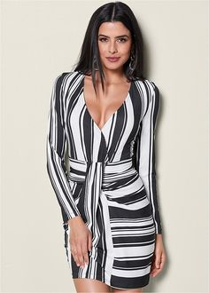 Make a statement in black and white styles with our Stripe Bodycon Dress. #venusfashion