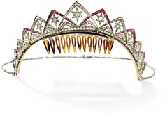 A Belle Epoque ruby and diamond necklace/tiara, 1915  Designed as graduating articulated v-shaped sections of old brilliant- and single-cut diamonds and calibre-cut rubies, each section centred with a similarly cut diamond star motif, to a later baton-link back chain, converts to a tiara with frame attachment, necklace length 43 cm, one diamond deficient.