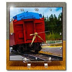 A red caboose of a train sitting on the tracks in Yellowstone Desk Clock