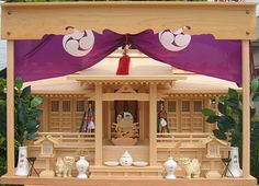 """Kamidana ( """"god-shelf"""") are miniature household altars provided to enshrine a Shinto kami. They are most commonly found in Japan, the home of kami worship."""