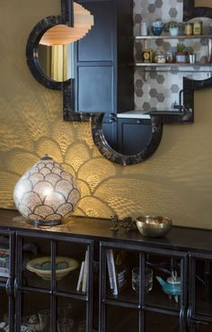 Oriental mirror and zenza standing light.