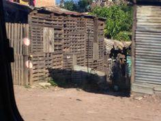 Homes alongside the road in Honduras. ExploreLocalUniverse.com