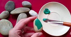 She finds and paints a couple of stones, then she realizes beautiful decorations with them!