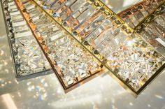WINDFALL Chandeliers - The JEWEL finishes available in steel, copper and gold