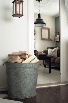 Love this tin bucket for firewood. Would be perfect next to our fireplace! Great idea! I hate tracking firewood throughout the house!