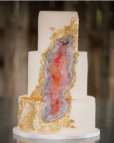 "This week the internet has been abuzz with a new trend in wedding cakes. While ""naked cakes"" have been all the rage the last few years, something new has been popping up from many a cake baker, and they will definitely rock your world. Enter: the geode cake. In case you're not familiar, geodes are volcanic creations that look like normal rocks on the outside, but when you split them open, they reveal a sparkling interior. The wedding cakes you see below all use sugar rocks to get that…"