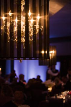 Small chandeliers are encased in sheer, striped globes for a romantic wedding touch.