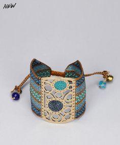 Manchette Mishky perles vertes/bleues métal doré Catcher Bleu / Vert prix promo Bijoux Monshowroom 102.50 €