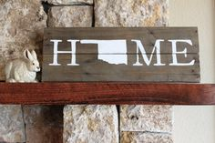 Rustic wooden sign handcrafted from reclaimed wood and hand-painted with the word HOME with an Oklahoma silhouette. It looks great propped up on your
