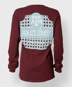 """This is the long sleeve version of our ever popular """"Classy Lady"""" shirt. The front features a maroon block ATM on the left side. The back has a unique pattern and has a white block ATM on the top with """"Gig 'Em Aggies"""", """"Texas A&M University"""", and """"Established 1876"""" all below the block ATM."""