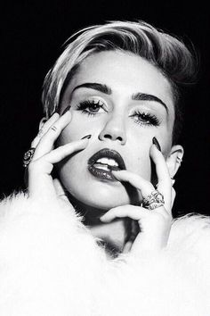 Miley Cyrus. She's beautiful because she has the guts to be herself in a world that's constantly trying to change you. She's an example if you ask me cause living the way others tell you isn't going to make you happy at the end of the day. So fuck what people think and live free.