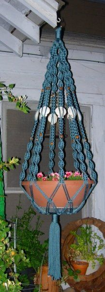 Image Hosting by PictureTrail.com:  I saw this plant hanger design on the Internet and just fell in love with it! The seashells were my own design. I had to figure out the yardage and knot design myself. It was a real challenge but I am very pleased with the end result!