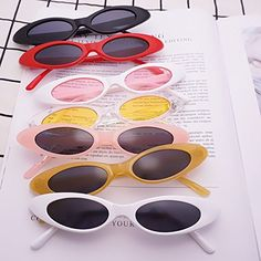 e090061fe1fb1 Amazon.com  FEISEDY Small Cat Eye for Women Sunglasses Clout Goggle Jelly  Glitter Sharp