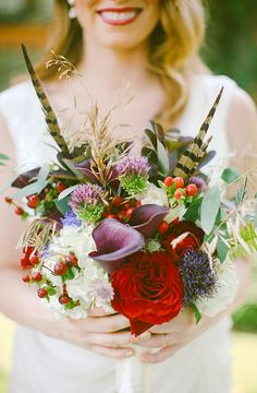 A wedding bouquet filled with berries, wheat, feathers, and calla lilies. #fallweddingbouquet, #feathers, fallweddingbouquet-arunabphoto.jpg, Aruna B. Photography