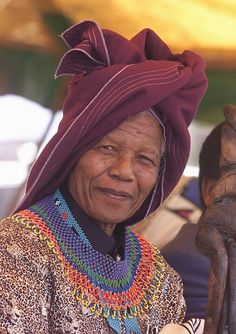 Former South African president Nelson Mandela wears a traditional Xhosa hat 11 February during a ceremony at his village of Qunu. Mandela celebrates anniversary of his release from the Robben Island jail. Nelson Mandela, We Are The World, People Of The World, African Culture, African American History, African Beauty, African Fashion, Xhosa Attire, Photo Souvenir