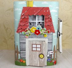 A Travel-sized Dollhouse- altered suitcase + scrapbook paper and embellishments