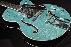 G6120CST TURQUOISE SPARKLE 3-PICKUP GUITAR.