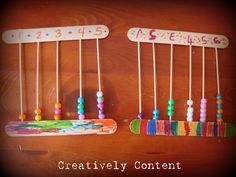 Create a DIY abacus using craft sticks, beads and toothpicks.  Brilliant way to help kids count.