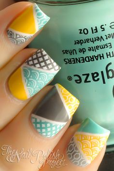 Geometric Pattern nail art: four color design: white base (OPI Alpine Snow) with yellow (Cult Nails Feel Me Up), mint green (China Glaze For Audrey) and grey (China Glaze Recycle) triangles and stamping with white #spring #summer #pastels #geometric #stamping #abstract #nailart #manicure 2013 | The Nail Polish Project