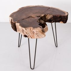 9 Ideas For Including Tree Stumps In Your Home Decor // Rescued tree stumps from Los Angeles serve as the table top of these handmade stools and tables.