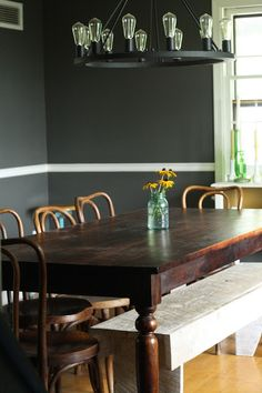 Bold dining room - love the white bench that adds a casual vibe
