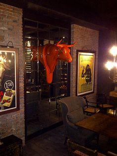 """SOLD: dEmo's """"TORO"""" in orange. Private wine cellar, Mexico City. www.robinrile.com"""