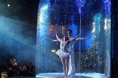 Ballet dancers dancing inside a snowglobe