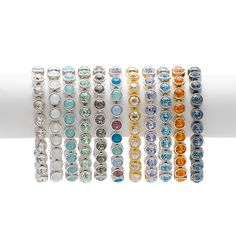"""Ice Bracelets $89-$125 Item 2615BF Ice Bracelets feature a continuous row of sparkling crystal with a single foldover clasp; 7 ¼"""" length.  Why stop with just one?! Pick your favorites to create a sparkling wrist party!  Available in:White Ice, White Opal, Pacific Opal, Chrysolite, Black Diamond, Multi-Opal, Golden Ice, Provence Lavender, Aquamarine, Tangerine, and Vintage Denim Blue.  Nadia Madjidi's Personal Website www.touchstonecrystal.com/nadia"""