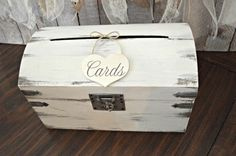 This wood distressed trunk and card sign combo is perfect to hold your wedding cards! The trunk color is antique white.The sign will come in your choice of distressed white, aqua, coral, blush pink,pale yellow,bright yellow,pale mint or lavender. Made of solid distressed wood with front latch and slot to insert cards,this trunk has a vintage feel. This trunk is so versatile,it goes great with almost any theme.Use this card box for a beach themed,woodland,rustic,shabby or barn wedding.Also…