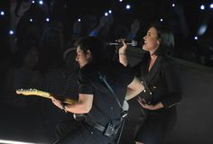 Demi Lovato and Brad Paisley performs onstage during the iHeartRadio Music Awards