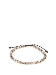'Evolving the male perception of accessories' is how M Cohen describes its design philosophy. This bracelet is strung from oxidised sterling-silver disc beads, and fastens with an adjustable nylon pull-cord for a personalised fit. Make it your new everyday signature.