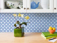 Absolutely loooove this idea of using stencils to create a motif back splash in the kitchen.