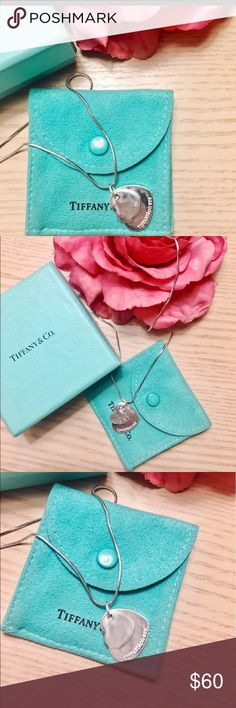 Tiffany & CO. DOUBLE HEART NECKLACE. Comes with pouch. One of the hearts says 925. I don't know if it is real or not as it was a gift. Tiffany & Co. Jewelry Necklaces