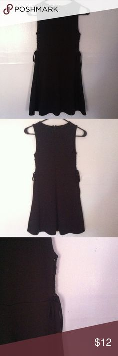 NWOT Forever 21 Sleeveless Skater Dress Small • new without tag • sleeveless skater style  dress with lace up ties on the side • half zipper in the back • color: black • brand: forever 21 • size: small • no trades •  •free gift with any purchase•15% off all bundles• Forever 21 Dresses Mini
