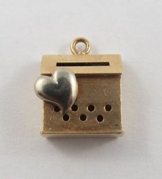 A personal favorite from my Etsy shop https://www.etsy.com/ca/listing/235174161/heart-mailbox-10k-gold-vintage-charm-for