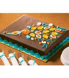 Paisley Peacock Cake = would look much better in blues & greens on a white cake
