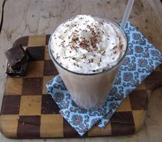 Mocha Milkshake    ½ cupsMilk, Divided  ½ ounces, weightBittersweet Chocolate  2 cupsVanilla Ice Cream  ½ teaspoonsVanilla Extract  ¼ teaspoonsInstant Espresso Powder  Whipped Cream And Additional Chocolate For Garnish