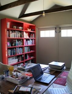 Only a step from the house but seemingly miles from distraction, a single garage bay has just the right dimensions for a no-frills home office.