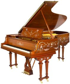 High Society grand piano by Steinway & Sons Skillfully replicated by Steinway master craftsmen in figured mahogany, this art case piano features double Empire-style legs, intricate hand-carvings and decorative, scrolling floral paintings that charmingly embody the passion and creative spirit of this great American composer. Mr. Porters original Steinway piano was created in 1907, and today distinguishes the lobby of the famous Waldorf Astoria Hotel in New York City.