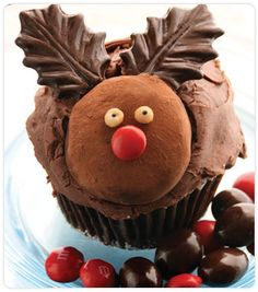 PREPARATION  1. Roll a homemade truffle in DOVE CHOCOLATE DISCOVERIES™ (DCD) Aztec Cocoa Dusting Powder and flatten slightly.  2. Add DCD Chocolate Leaves as antlers and 1 red M&M® for his nose. Using marzipan or frosting, add eyes.  3. Place Red-Nosed Rudolph truffle on cupcake.