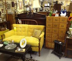 At Phantastic Phinds In Erdenheim A Retro Love Seat Covered With Yellow Corduroy Sits Next