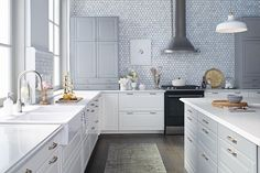 like this white & grey kitchen from Ikea .. put straight edge on countertop, reduce the tiling on backsplash/walls